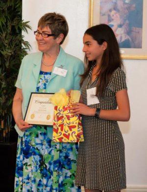Contest Winner Eloisa Castillo, Presented By Pat Christie, Executive Administrator Pat Christie